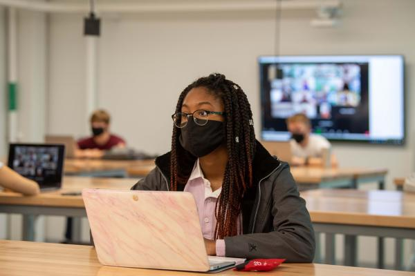Kent State's Giving Tuesday campaign raises funds to keep students on track to graduation, like the students pictured here who are safely participating in their class while adhering to the university's COVID-19 guidelines.