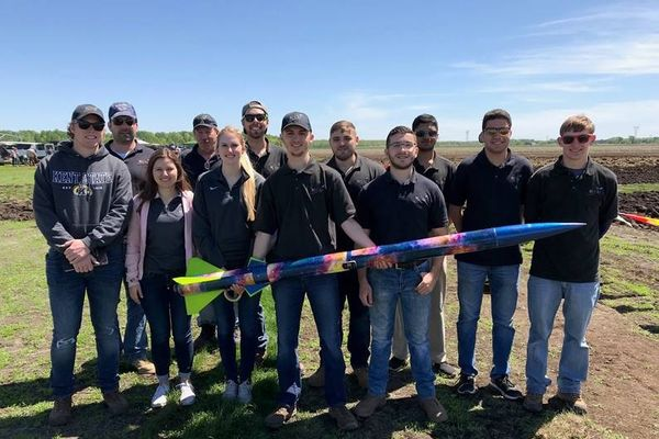 photo High Power Rocket Club holding colorful rocket