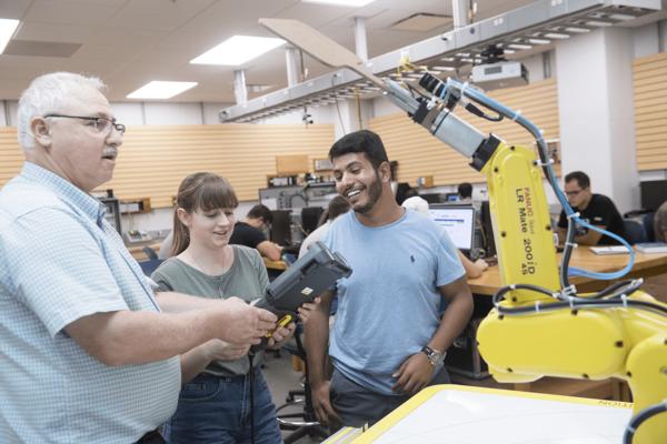 Darwin L. Boyd With Robot Arm