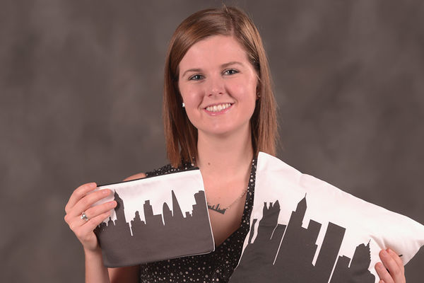 Anne Skoch, a junior fashion merchandising major, shares the skyline pillows that will be part of her new online boutique, Anne Cate.