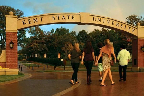 Students walk through the arch on the esplanade
