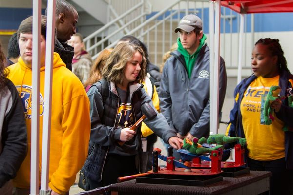 A student plays a carnival game at WinterBlast