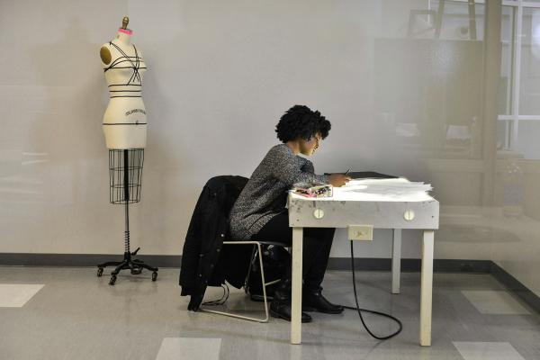 A fashion student works in Rockwell Hall
