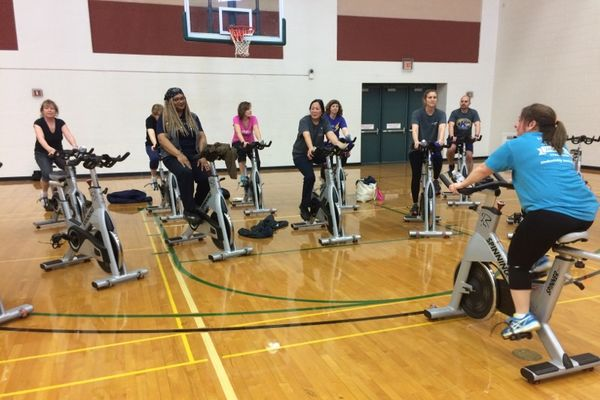 employees spinning at rec and play day 2018