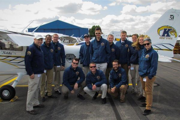 photo Kent State Precision Flight Team in front of Top Hawk Nikki