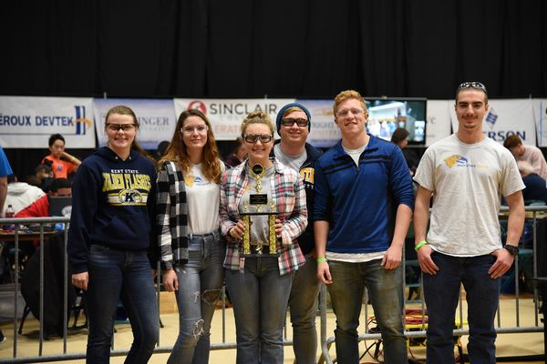 photo X-Bots student organization members accepting trophy