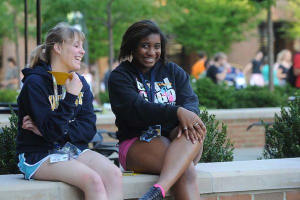 Students are all smiles on a warm and sunny day.