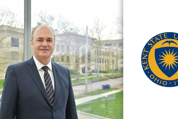 President pictured with University Seal