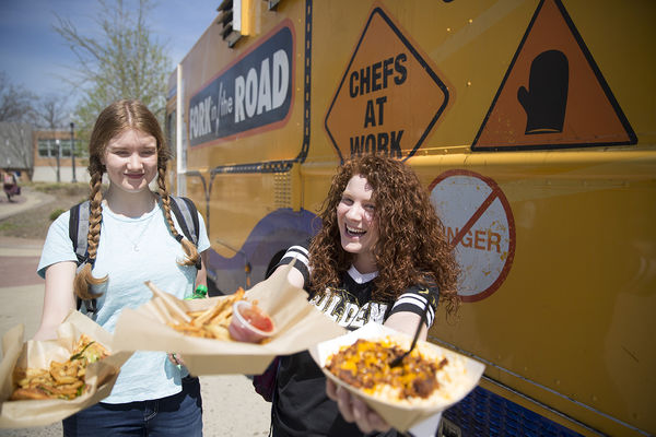 Kent State students show off food purchased from Dining Services' Fork in the Road Food Truck.