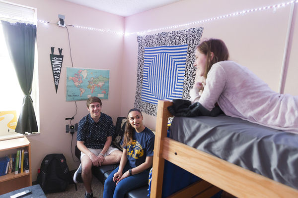 Students in chat in a dorm room on the Kent Campus.