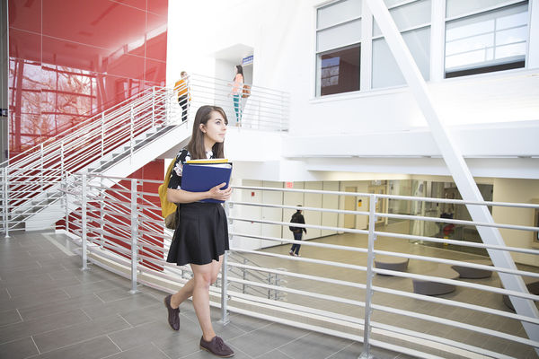 A student walks through the new Center for the Visual Arts building on the Kent Campus.