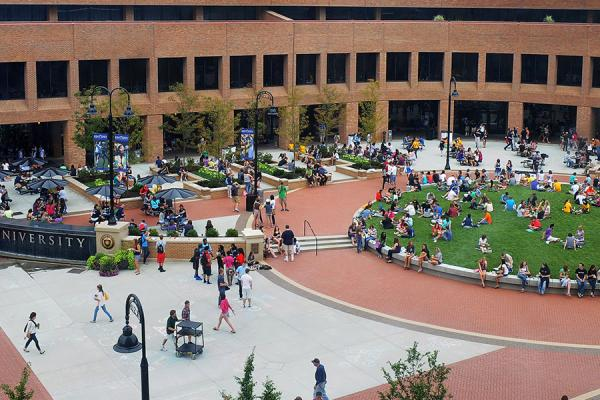 Group of people outside in Risman Plaza at Kent State