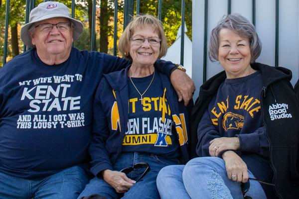 Photo of alumni smiling for the camera during Kent Homecoming