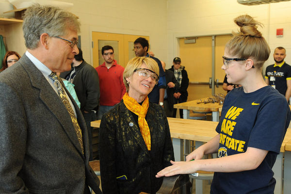 Trustee Chair, Dennis Eckhart, President Warren talk with Appllied Engineering Student at ATB Open House