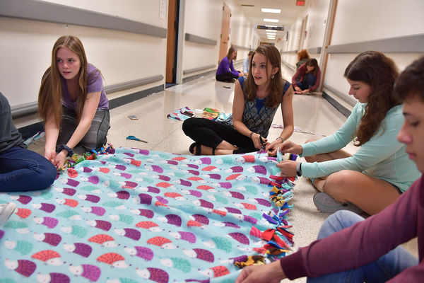 Students working on making a blanket