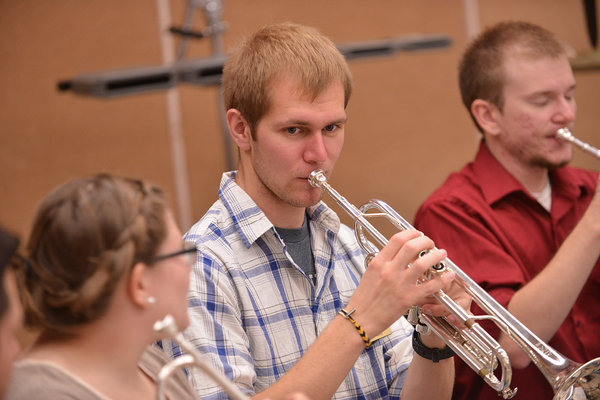 A student plays a trumpet for an instructor