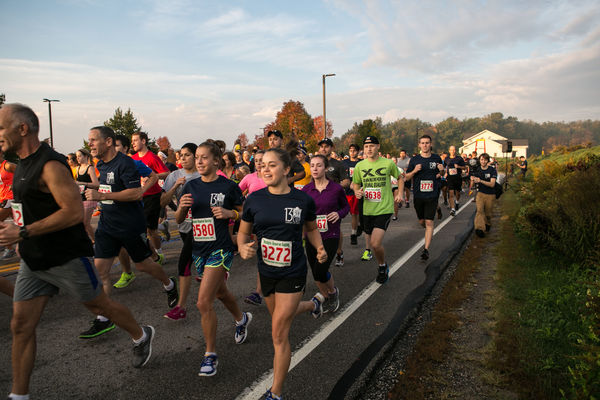 A group of runners make their way down the street behind the Student Recreation and Wellness Center in the early morning