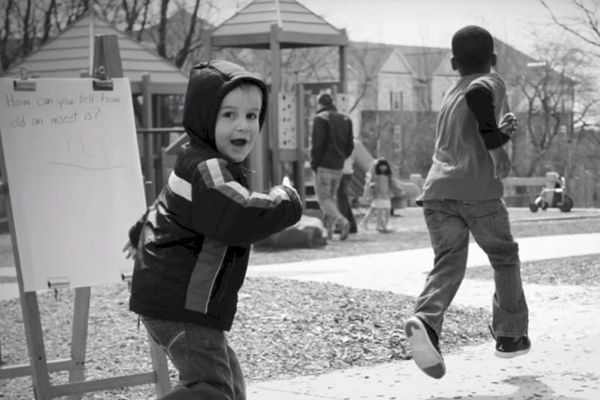 Children running outside - still from Day in the Life video