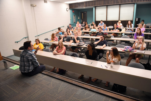A professor in the School of Communication Studies gives a lecture to students majoring in disciplines across the College of Communication and Information.