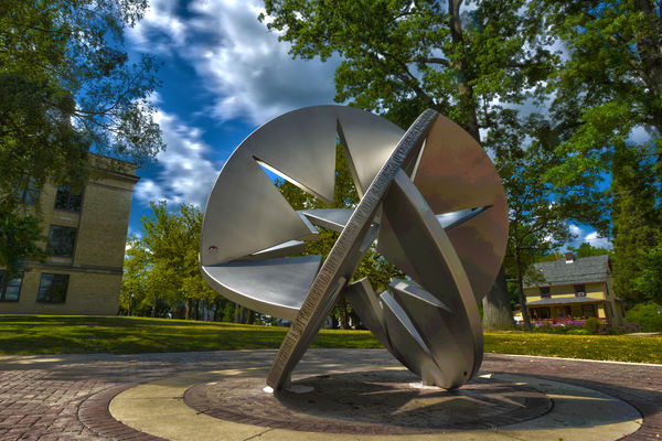 """Star Sphere 2010"" by Susan Ewing stands in front of Franklin Hall as seen in this HDR Image. it is part of the ""Sculpture Walk"" along the University Esplanade."