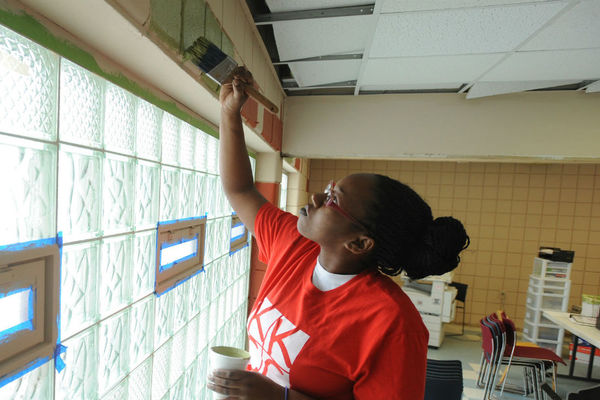 Student volunteer painting