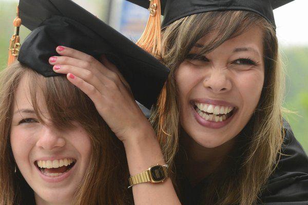 Two Kent State graduates celebrate their achievement