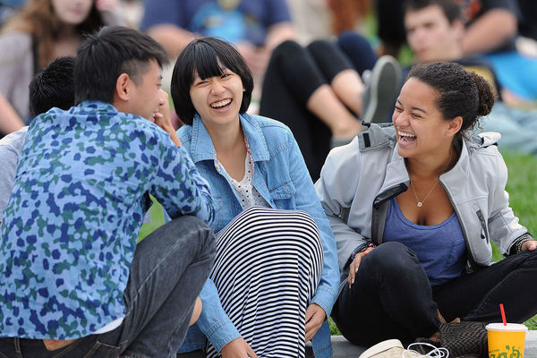 A group of students laughing together.