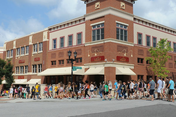Students crossing the street in downtown Kent