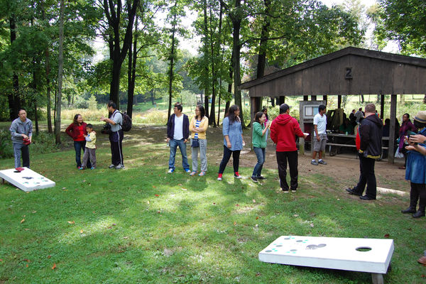 Students play yard games at the annual departmental picnic.