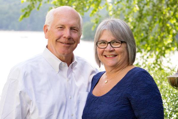 Eric Herr (left) and Rebecca Herr (right) pose near a lake