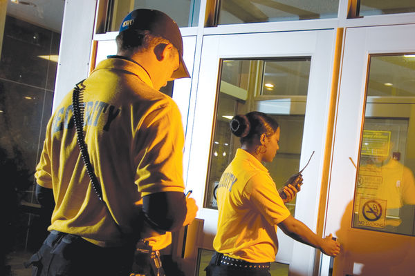Campus security aides enter a building on the Kent Campus.