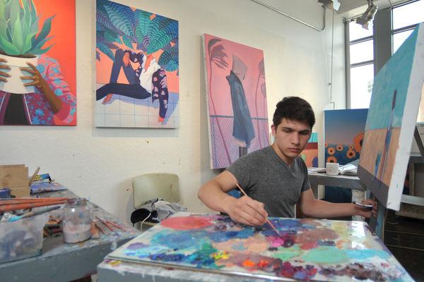 Student Kade Marsili painting