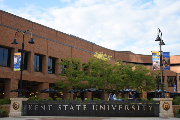 Photo of Risman Plaza and Kent State University sign, on a sunny day
