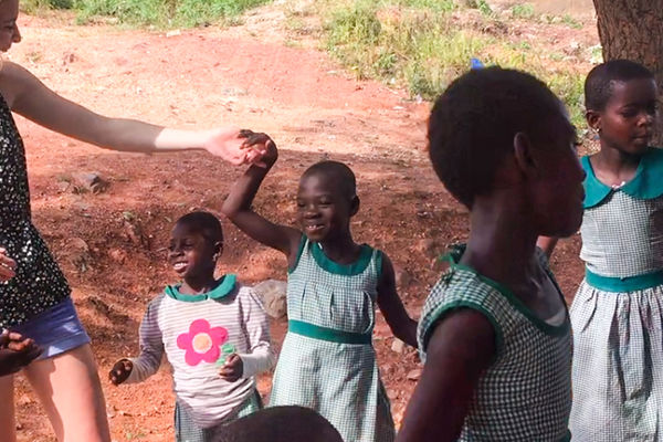 Student dancing with children