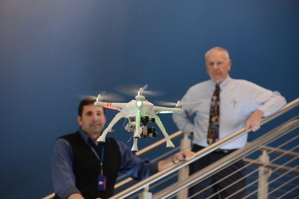 Dean and Dr. Stringer watch UAV