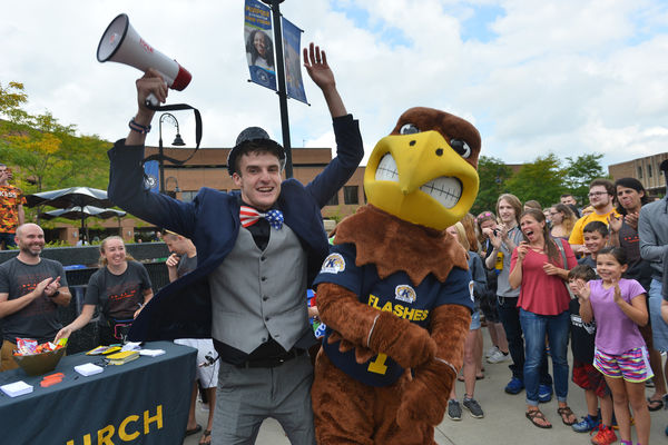 A Kent State student posing for a picture with the mascot.