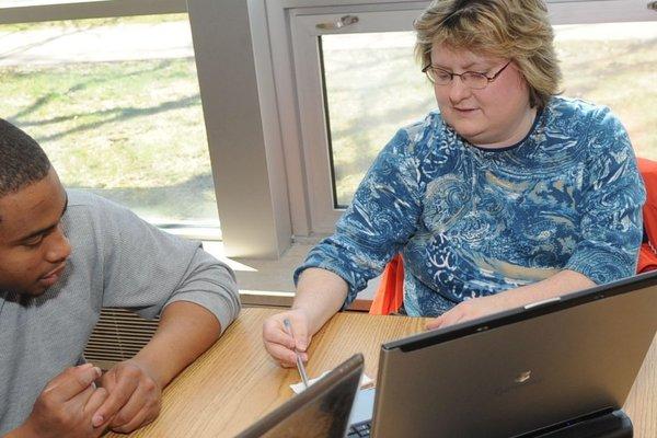 Advisor helping student.