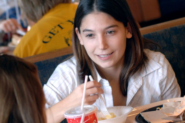 Two students enjoy lunch in the newly remodeled Eastway Center