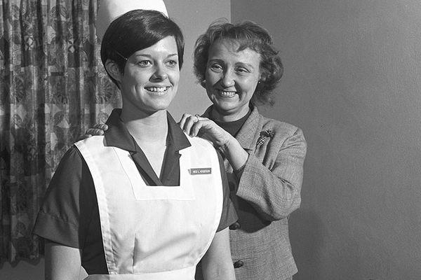 A student models the first Kent State nursing uniform