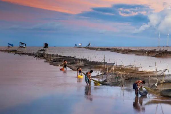 Fishers along the coast