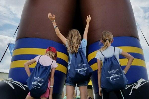 photo girls embrace Kent State Aeronautics at the EAA AirVenture