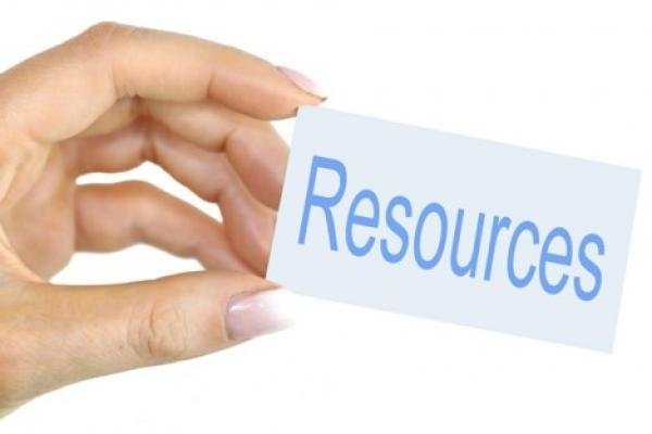 hand with sign that reads resources