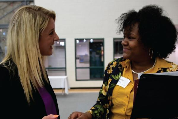A student and a prospective employer discuss prospects.