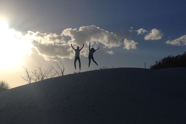 Jumping at the top of the hill in the middle of the winter.