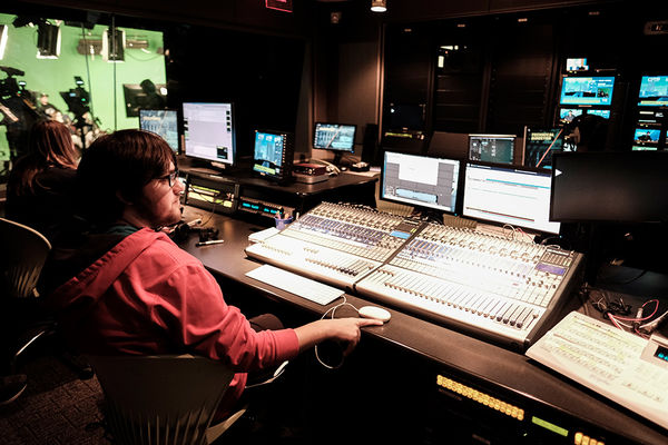 A Student sits in the control room during a TV2 broadcast