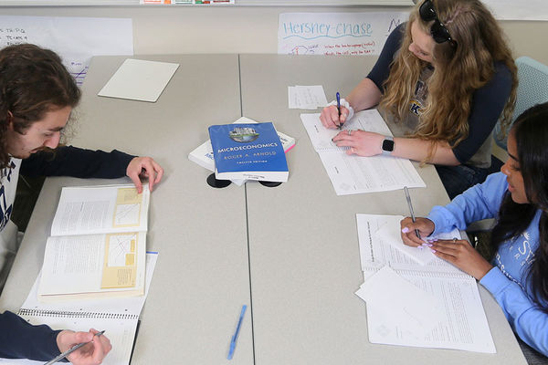 Three students study in a supplemental instruction session