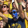 Kent State University students attempt to get the attention of cheerleaders who were throwing T-shirts into the crowd during the Homecoming football game.
