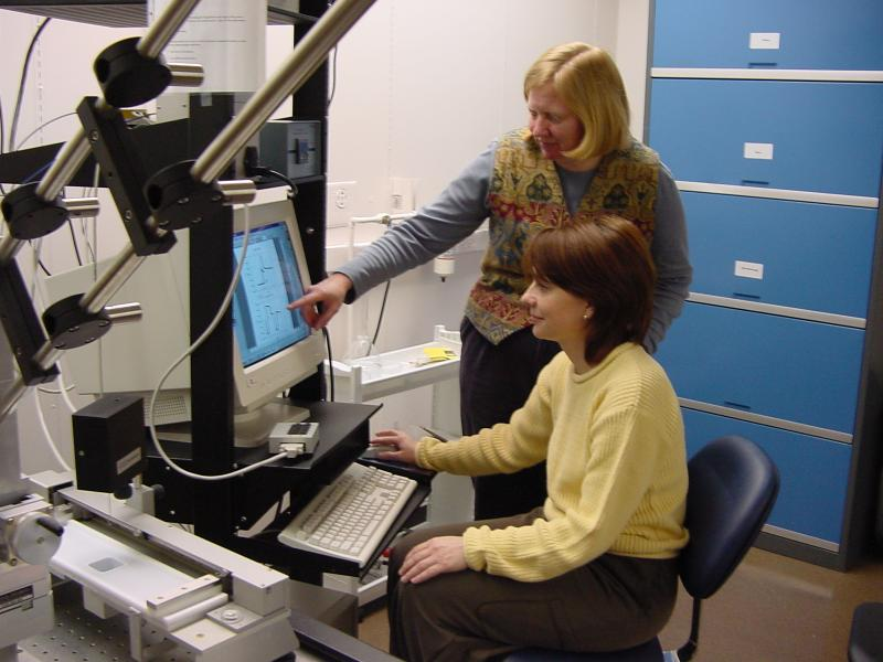 Svetlana Primak (seated) discusses properties of a molecularly-thin polymer layer with her PhD Physics adviser, Prof. Elizabeth Mann.
