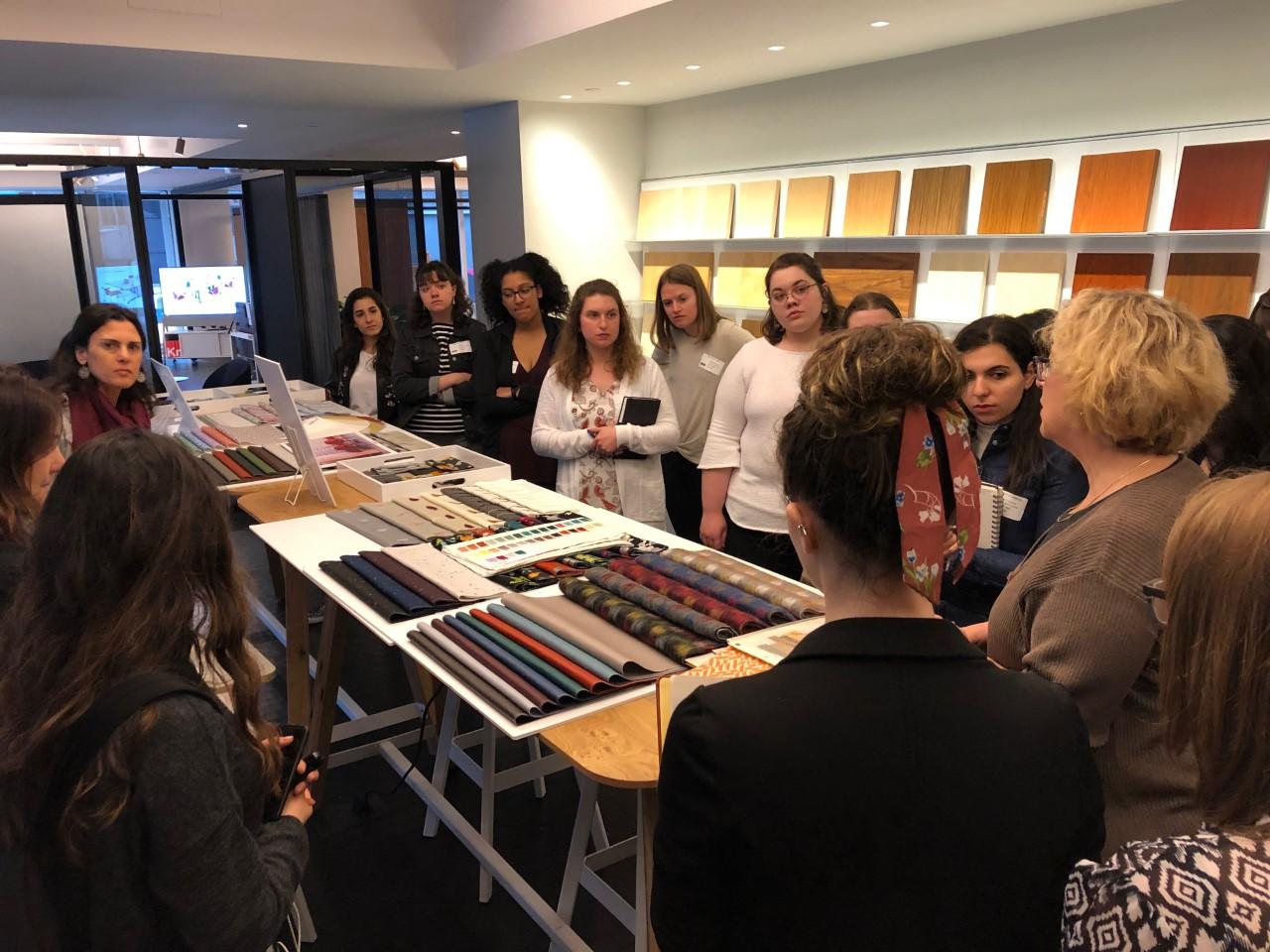 students looking at fabric at a studio