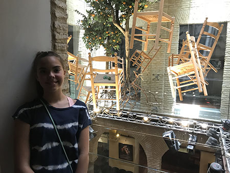Steven Brown, adjunct instructor, College of Education, Health and Human Services, vacationed in Spain with his wife Casey and daughters Robyn and Lexi, spending time in Seville, Granada and Barcelona. Pictured is Lexi at the Flamenco Museum in Seville.